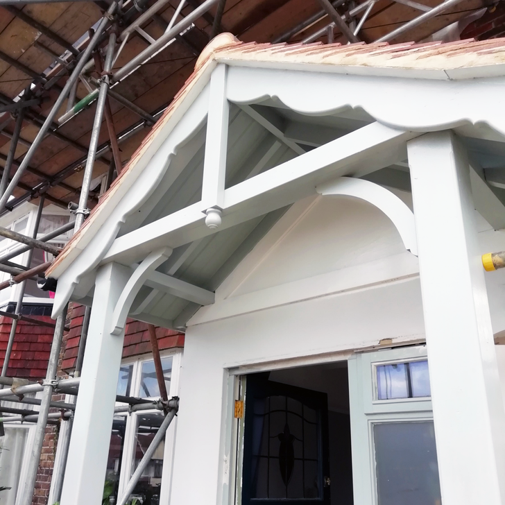 A bespoke, custom made timber door canopy on post legs